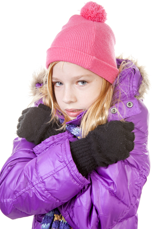 young girl in winter outfit heaving cold over white background photo