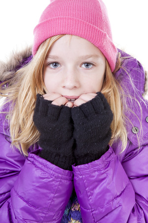 blonde girls: Teenage girl is posing in winter outfit over white backgroung