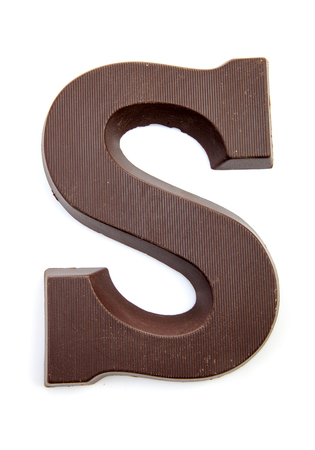 Chocolate letter S for Sinterklaas, event in the Dutch in december over white background