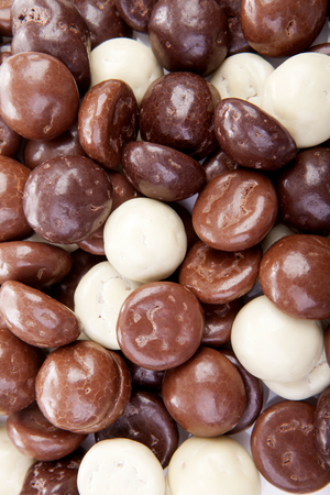 sinterklaas: Typical dutch sweets: chocolate pepernoten (ginger nuts) for Sinterklaas; celebration at 5 december in the Netherlands in closeup Stock Photo