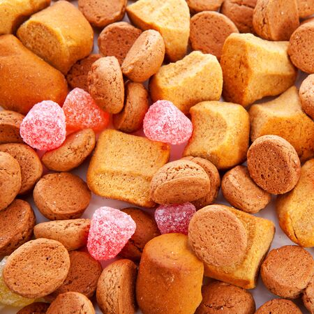 5 december: Typical dutch sweets: pepernoten (ginger nuts) for Sinterklaas; celebration at 5 december in the Netherlands in closeup Stock Photo