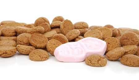 '5 december': Closeup of typical Dutch sweets: pepernoten (ginger nuts) for Sinterklaas; celebration at 5 december in the Netherlands over white background