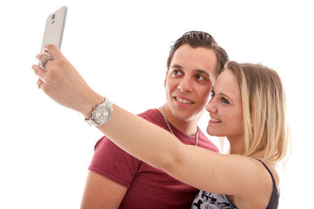 Young couple making selfie over white background Stock Photo