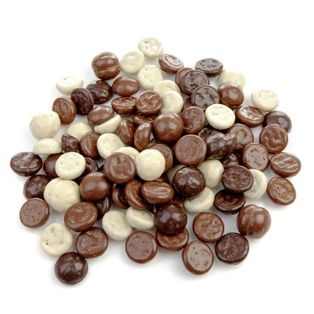 '5 december': Typical dutch sweets: chocolate pepernoten (ginger nuts) for Sinterklaas; celebration at 5 december in the Netherlandsover white background