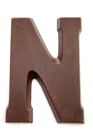 Chocolate letter N for Sinterklaas, event in the Dutch in december over white background