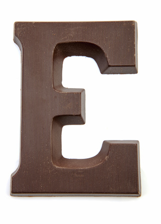 zwarte: Chocolate letter E for Sinterklaas, event in the Dutch in december over white background Stock Photo