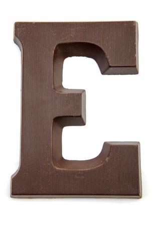 zwarte: Chocolate letter E for Sinterklaas, event in the Dutch in december over white background Stock Photo