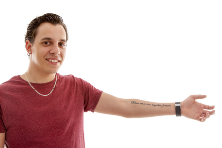 Young man is showing his tattoo on arm over white background
