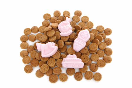 '5 december': Typical Dutch sweets: pepernoten (ginger nuts) for Sinterklaas; celebration at 5 december in the Netherlands over white background
