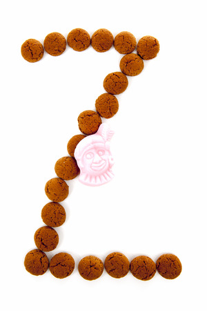 dutch typical: Ginger nuts, pepernoten, in the shape of letter Z isolated on white background. Typical Dutch candy for Sinterklaas event in december