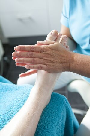 Massage of feet by pedicure