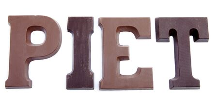 The word PIET in chocolate letters isolated on white background, typical Dutch candy for Sinterklaas event in december
