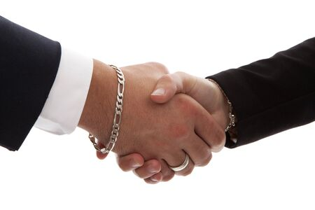 Two persons shaking hands in closeup over white background Stock Photo