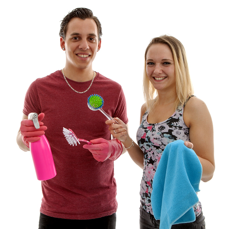 Young couple with cleaning supply over white background