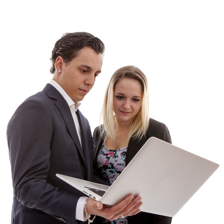 Young business couple is holding laptop over white background