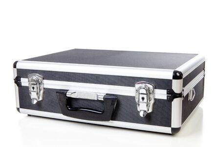 closed business suitcase over white background