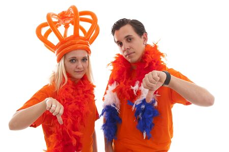 dutch girl: Couple of Dutch soccer supportersfeeling down over white background