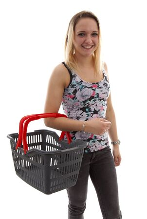 Young woman is doing grocerys with empty basket over white background Stock Photo