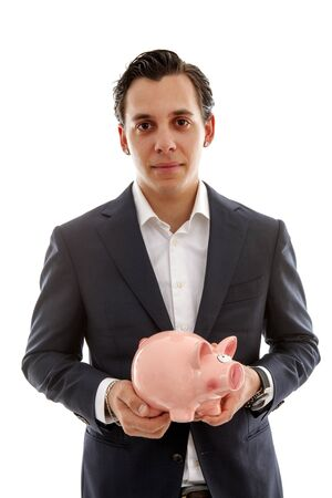 Businessman is holding piggy bank over white background Stock Photo
