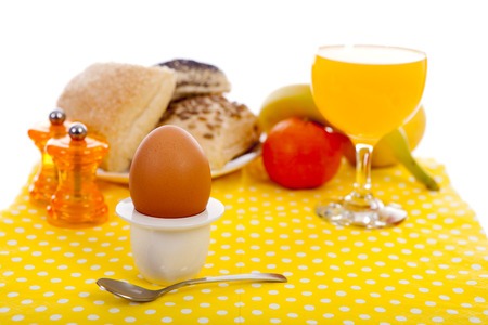 Easter breakfast with egg, bread, fruits and drinks Stock Photo