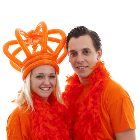 dutch girl: Couple of Dutch soccer supporters over white background
