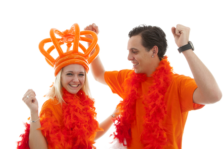 dutch girl: Couple of Dutch soccer supporters cheer over white background