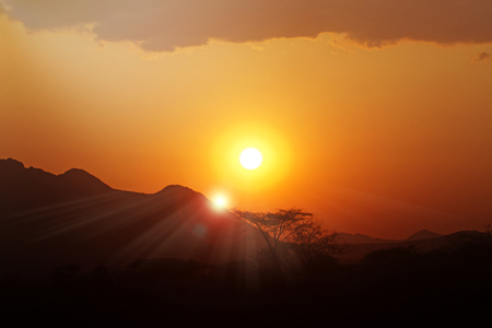 Stunning sunset in Kenya, Africa with dramatic sun flare