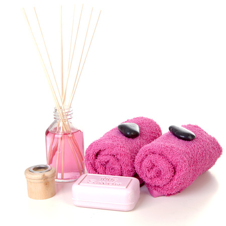Pink spa accessories over white background