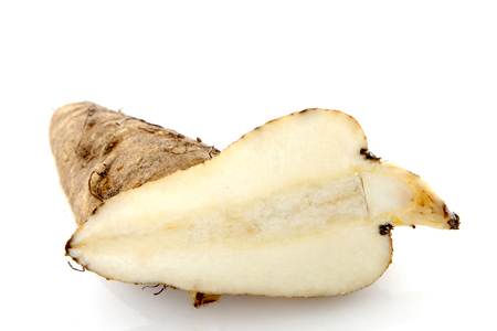The Jerusalem artichoke (Helianthus tuberosus), also called the sunroot or sunchoke or earth apple or topinambur cut. Over white background Stock Photo