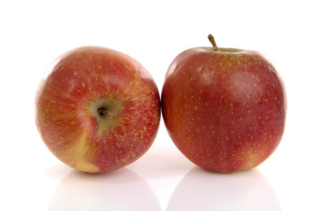 Two red appels over white background