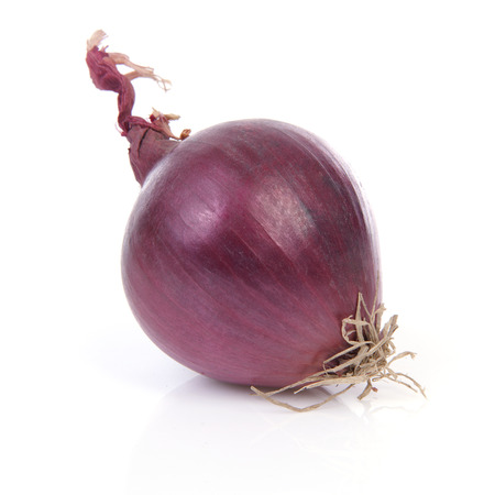 One whole red raw onion over white background Stock Photo
