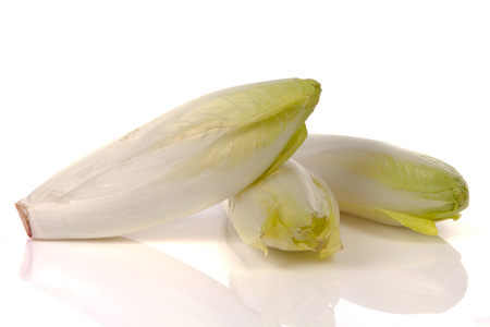 Pile of fresh raw chicory over white background Stock Photo