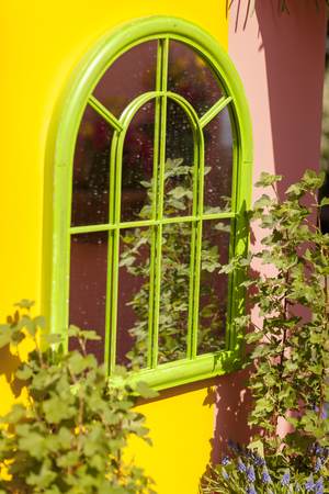 Colorful scenery with green window mirror