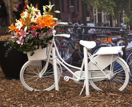 Typical Dutch scenery with white bicycle in Amsterdam Stock Photo