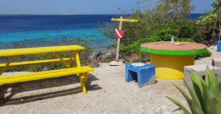 Colorful diving place to rest on Bonaire beach