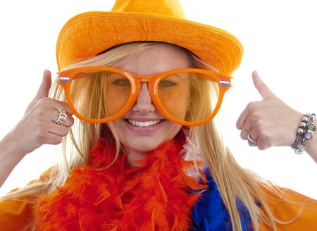 Dutch young woman in orange outfit is ready for the soccer game over white