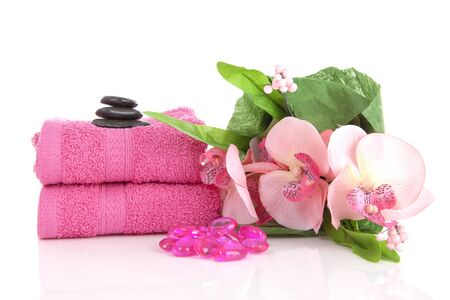 Pink towels and spa objects for relaxation over white background Banque d'images