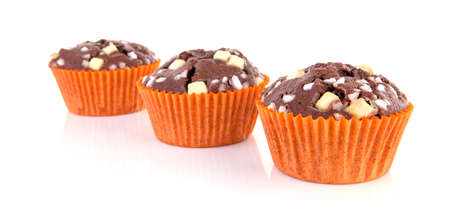 Three delicious homebaked brownie cupcakes over white background Stockfoto