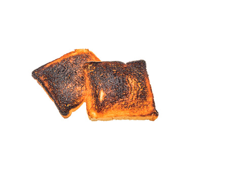burnt toast: Burnt toast bread isolated white backround with clipping path stock photo Stock Photo