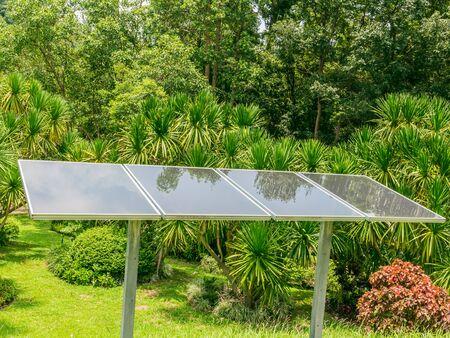 alternativ: Solar energy panels in forest Stock Photo