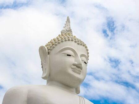 budda: finger White buddha statue in thailand temple in blue sky background