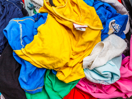 frenzied: Pile of dirty colorful cloth. Preparing for wash.