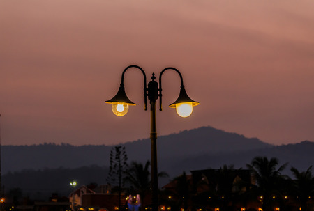 street lamps: Street lamps  mountain background.