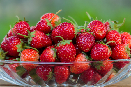 Fresh strawberry fruit in a glass dish