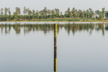 depth measurement: water level indicator at the waterway or swamp