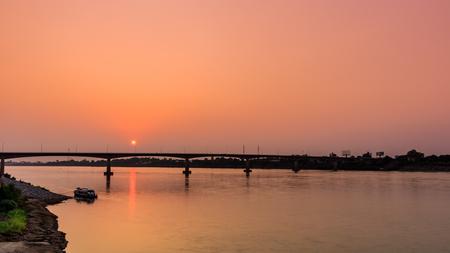 Bridge across the Mekong River at sunset. Thai-Lao friendship bridge at Nong Khai Thailand Stock Photo