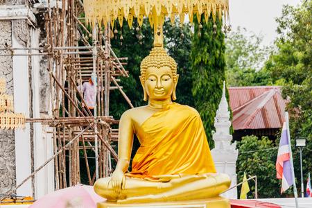 dyllic: Buddha statue at Wat PraThat ThaUthen , Nakhonphanom Thailand.