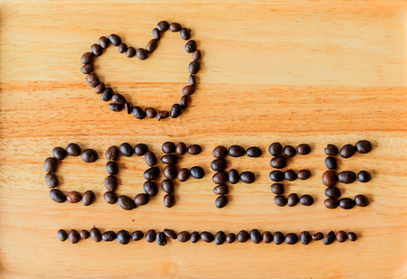 literally: Coffee beans are literally coffee on a wooden floor.