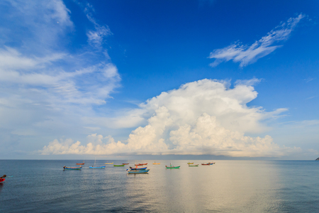 Sandy beaches and colorful fishing boats