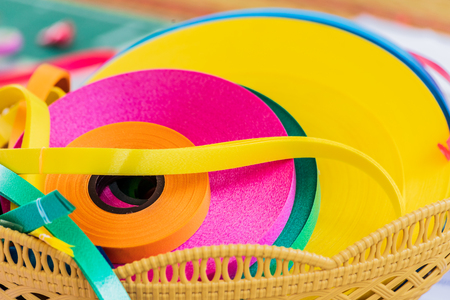 colored ribbons in rolls on a basket